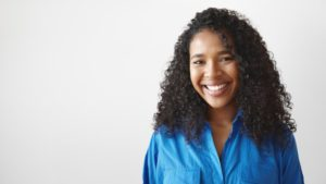 Woman with beautiful teeth after visiting cosmetic dentist in Cary